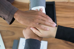 Young businessman joining hand, business team touching hands tog. Young asian businessman joining united hand, business team touching hands together after Royalty Free Stock Photos