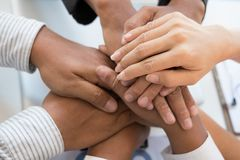 Young businessman joining hand, business team touching hands tog. Young asian businessman joining united hand, business team touching hands together after Royalty Free Stock Images