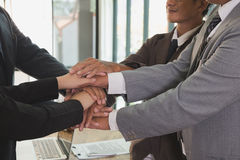 Young businessman joining hand, business team touching hands tog. Young asian businessman joining united hand, business team touching hands together after Stock Image
