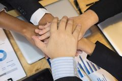 Young businessman joining hand, team of business people touching Royalty Free Stock Photography