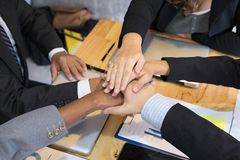 Young businessman joining hand, team of business people touching Stock Image