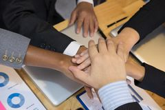 Young businessman joining hand, team of business people touching Stock Images