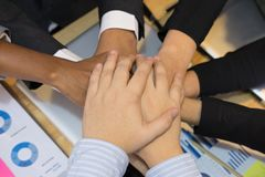 Young businessman joining hand, team of business people touching Royalty Free Stock Photos