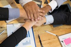 Young businessman joining hand, team of business people touching Stock Photo