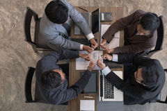 Young businessman joining hand together, business team giving a Royalty Free Stock Photos