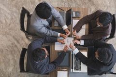 Young businessman joining hand together, business team giving a Stock Photos
