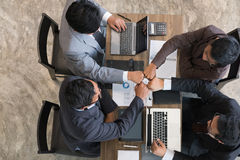 Young businessman joining hand together, business team giving fi Stock Image
