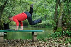 Young businessman jump outdoor Stock Photo