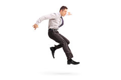 Young businessman jumping in the air Royalty Free Stock Images