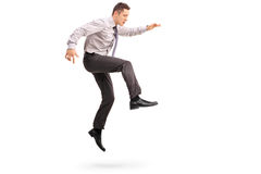 Young businessman jumping in the air Royalty Free Stock Photos