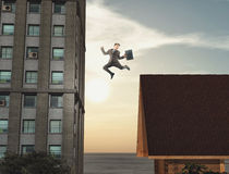 Young businessman jumping Stock Photo