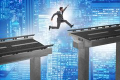 The young businessman jumping over the bridge Stock Photos