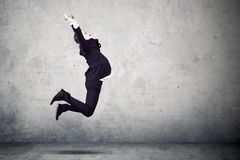 Young businessman jumping to celebrate his success Stock Images