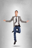 Young businessman jumping on yoga position. Stock Photography