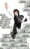 Young businessman jumps through dollars. The young businessman jumps through dollars Royalty Free Stock Photo