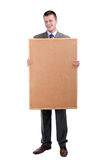 Young businessman keeping cork board Royalty Free Stock Image