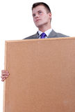 Young businessman keeping cork board Stock Photo