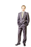 Young businessman keeps hands in pockets Stock Image
