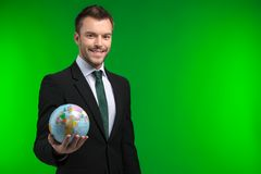 Young businessman keeps world in his hand. Stock Image