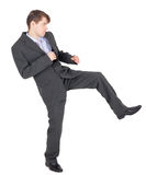 Young businessman kicks as karate Stock Images