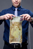 Young businessman is knitting a euro banknote Stock Photo