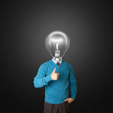 Young businessman with lamp-head. Shows well done Stock Photos