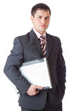Young businessman with laptop Royalty Free Stock Images