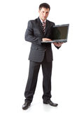 Young businessman with laptop Royalty Free Stock Photos