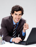 Young businessman on laptop Stock Photography