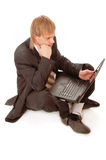 Young businessman with laptop Royalty Free Stock Photography