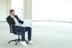 Young businessman with laptop stock images