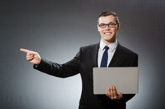 The young businessman with laptop in business concept Royalty Free Stock Photo