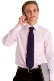 Young businessman with laptop and cellphone Royalty Free Stock Photos