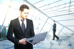 Young businessman with laptop Royalty Free Stock Photo