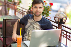 Young businessman with a laptop Stock Photo