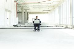 Young businessman with laptop stock image