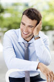Young businessman laughing Royalty Free Stock Photos