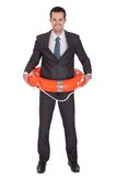 Young businessman with life buoy. Isolated on white Royalty Free Stock Photo