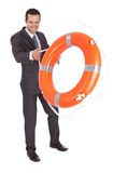 Young businessman with life buoy Stock Images