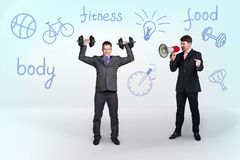 Young Businessman Lifting Dumbbell Royalty Free Stock Photos