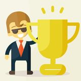 Young businessman lifts trophy Stock Photography