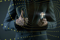 The young businessman with light bulb in idea concept Stock Photos