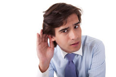Young businessman listening Royalty Free Stock Photos