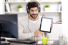Young businessman listening music Stock Image