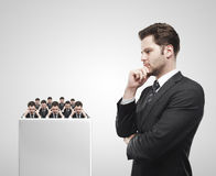 Young businessman look at the group of businessme royalty free stock photography