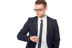 Young businessman look at his watches, isolated Stock Images