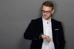 Young businessman look at his watches Stock Photography