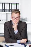 Young businessman is looking above his glasses Stock Photography