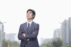 Young Businessman Looking Away Stock Images