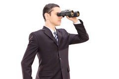 Young businessman looking through binocular Royalty Free Stock Images